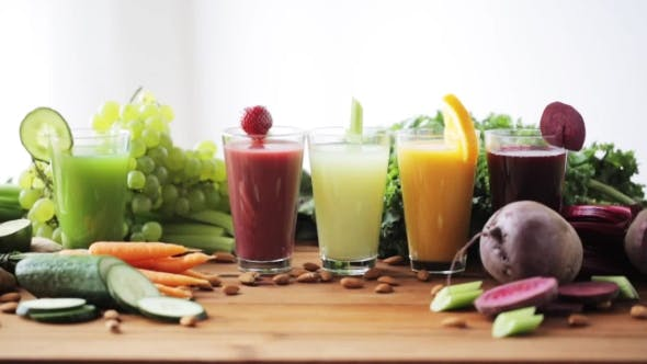 Thumbnail for Hand Putting Glass Of Vegetable Juice To Table
