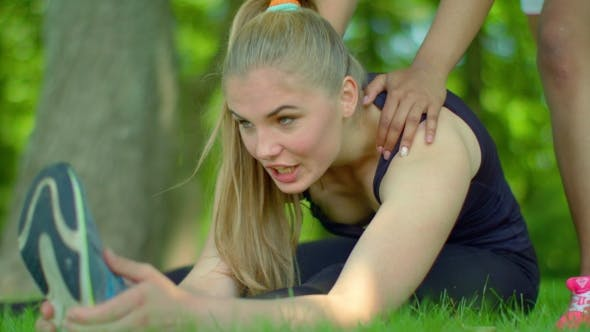 Fit Girl Stretching In Park.  Of Blonde Woman Expressing Negative Emotion