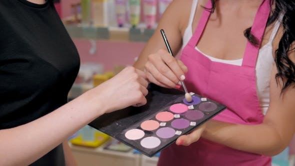 Thumbnail for Pretty Young Woman In Perfumery Shop Choose Cosmetics With Cosultant