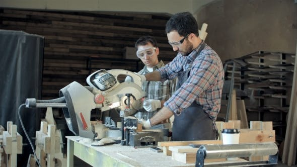 Thumbnail for Two Carpenters Works On Woodworking Machine In Workshop.
