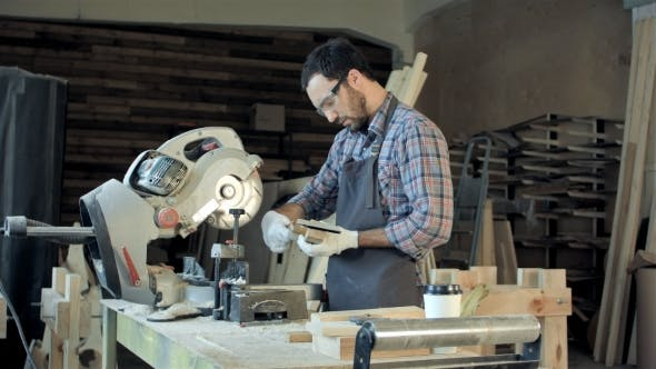 Thumbnail for Confident Young Male Carpenter Working With Wood In His Workshop