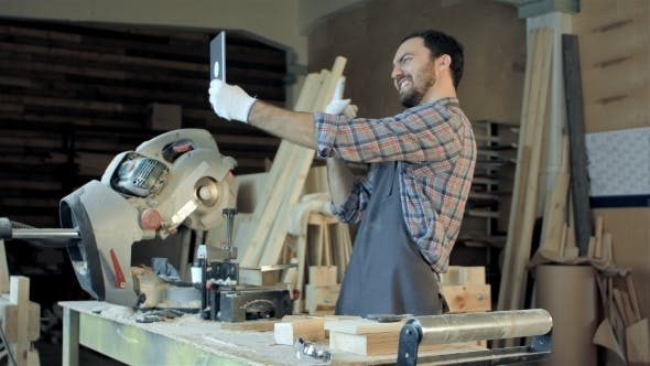 Thumbnail for Carpenter Makes Selfie Near Woodworking Machines In Carpentry Shop.