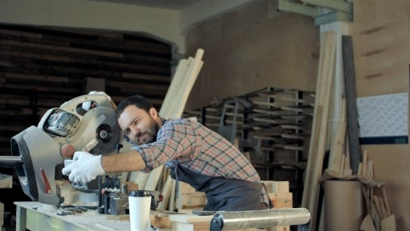 Thumbnail for Smiling Workman With Beard Makes a Selfie Using His Smart Phone