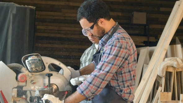 Thumbnail for Carpenter Shows Student How Work With Electric Saw