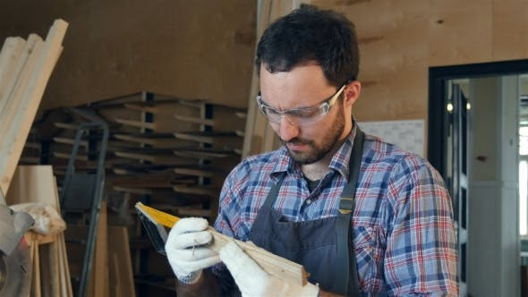 Thumbnail for Bearded Carpenter Works With Wooden Bar In Workshop