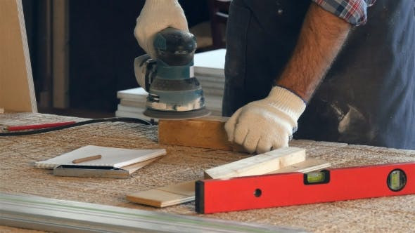 Thumbnail for Man Working With Wooden Planck and Electric Planer in Workshop.