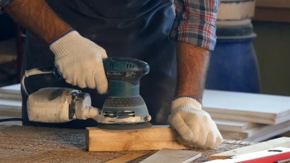Thumbnail for The Carpenter Working With Electric Planer on Wooden Plank in workshop