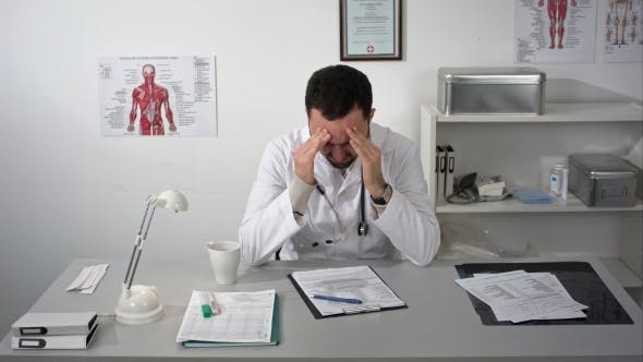 Thumbnail for Tired Doctor At Medical Cabinet