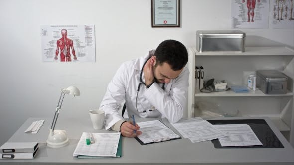 Cover Image for Tired Medical Doctor Man In Office With Pain In The Neck