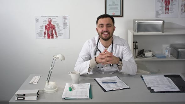 Thumbnail for Friendly Doctor Talking To Camera