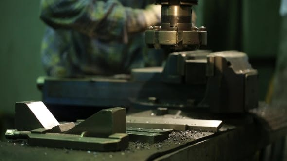 Thumbnail for Factory Worker Sets Metal Piece In Vise Of a Milling Machine.
