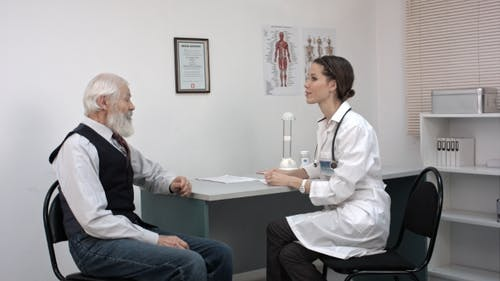 Young Doctor Talking To The Elder Man