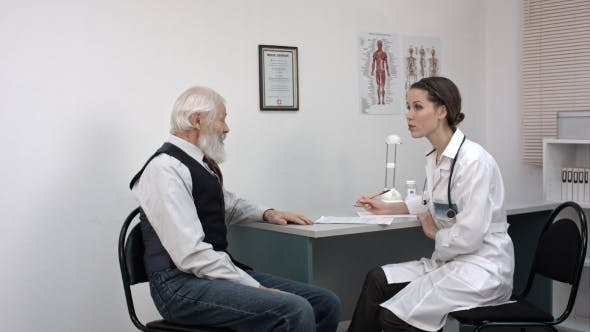 Thumbnail for Happy Doctor And Patient Discussing Over Reports In Clinic.