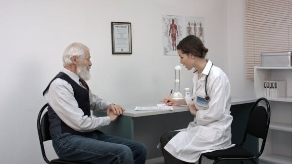 Thumbnail for Doctor Talking To Senior Man At Her Office.