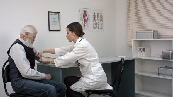 Cover Image for Doctor Checking Old Man Patient Arterial Blood Pressure. Health Care.