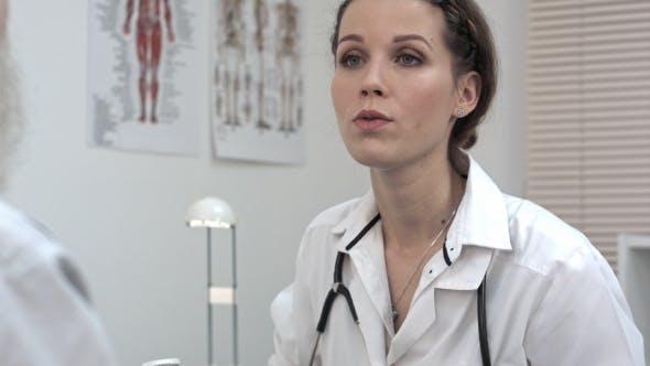 Thumbnail for Beautiful Female Doctor Holding Bottle Of Pills.