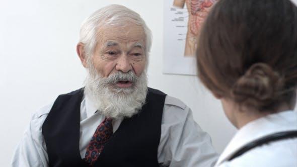 Thumbnail for Senior Old Man Talking To Doctor At Hospital.