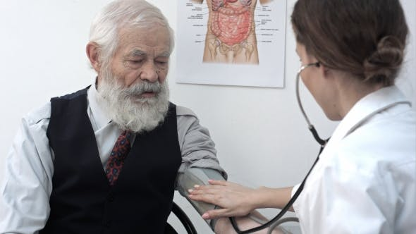Cover Image for Doctor Measuring Blood Pressure Of Male Patient.