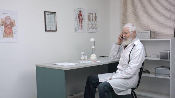 Thumbnail for Senior Pharmacist Talking On The Phone.