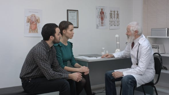 Doctor Talking To The Couple.