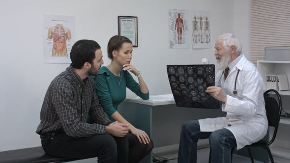 Thumbnail for Healthcare And Medical Concept. Doctor With Patients Looking At X-ray.
