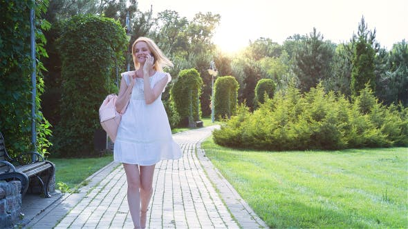 Thumbnail for Beautiful Girl Walking Alone in the Park at Sunset 3
