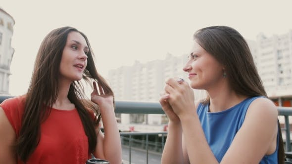 Thumbnail for Two Attractive Brunette Women Best Friends Drinking Coffee In Cafe And Talking After Shopping.