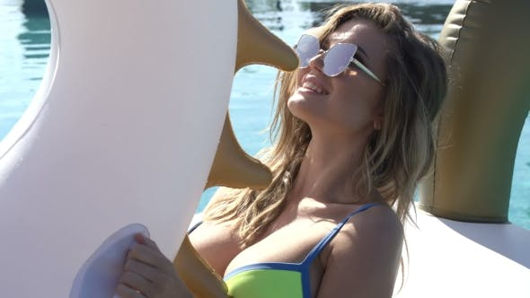 Thumbnail for Sexy Woman In Bikini Enjoying Summer Sun And Tanning During Holidays In Pool With Cocktail