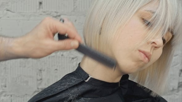 Thumbnail for Hairdresser Cuts Blond Hair With Scissors