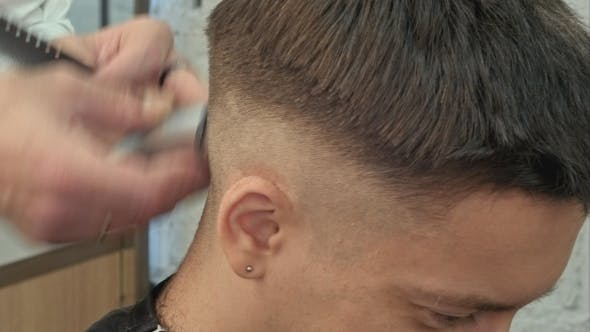 Thumbnail for Hairdresser Cutting With Trimmer Hair Of Man Client At Beauty Parlour