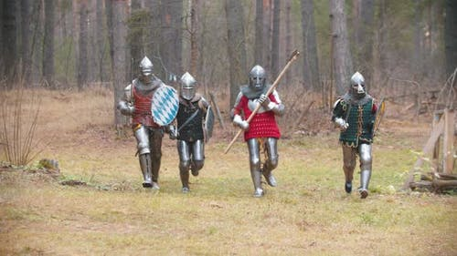 Four Men Knightes Running in the Row in the Forest in Full Armour