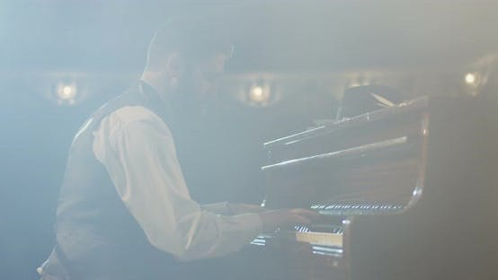 Thumbnail for Man Playing Piano on the Stage