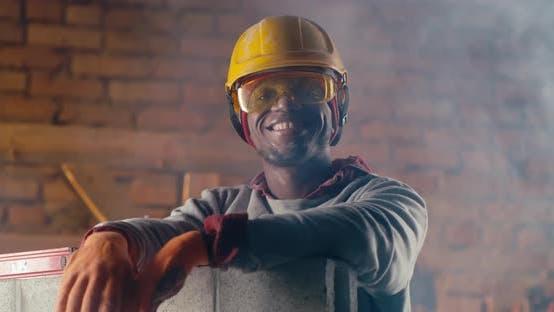 Cheerful Black Man on Construction Site