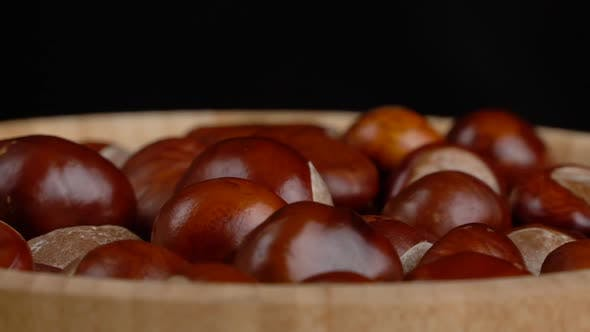 Thumbnail for Chestnuts in a Wooden Bowl Rotate on Black Background
