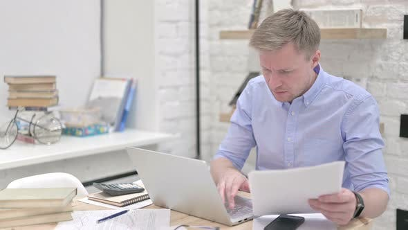 Thumbnail for Businessman Reading Documents While Working