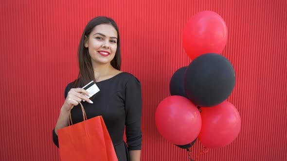Thumbnail for Good Buy in Seasonal Sale, Shopper Woman Kisses Plastic Card and Enjoys Discounts at Black Friday