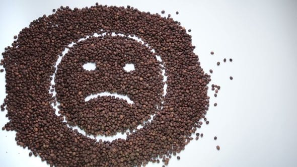 Sad Smiley Made Of Coffee Beans Becoming Happy