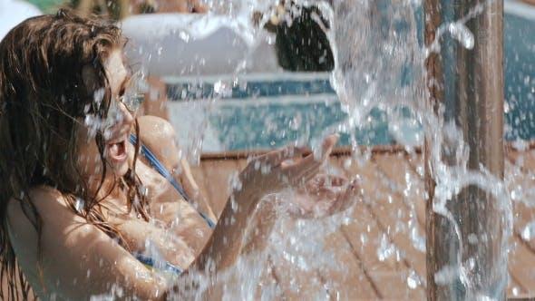Thumbnail for Young Beautiful Woman Taking a Shower Outdoors In Bikini Super