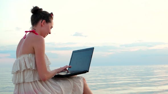 Thumbnail for Girl With Laptop On The Beach Slender Young And Beautiful Tapping On Keyboard.