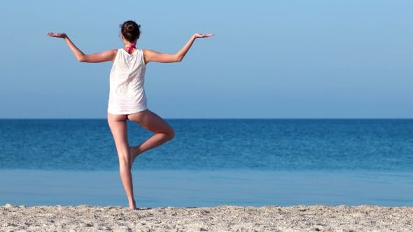 Thumbnail for Sexy Girl With a Beautiful Ass, Practices Yoga On The Beach, Sand Beach.