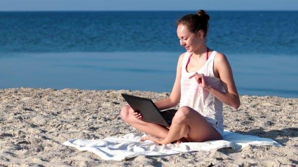 Thumbnail for The Girl On The Beach Speaks, Communication Via The Internet, Smiling.