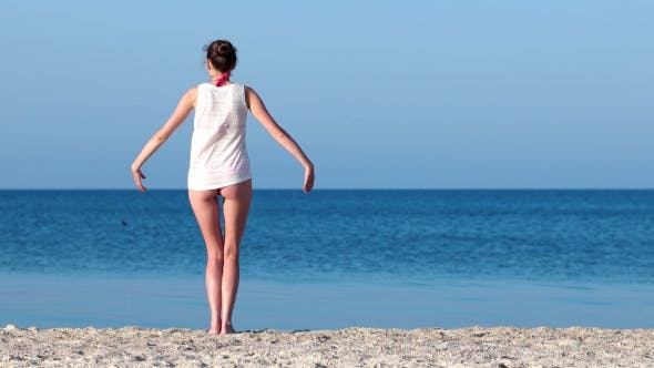 Thumbnail for The Seashore, The Spirit Of Freedom Beautiful Girl Raises Her Arms To The Sky,