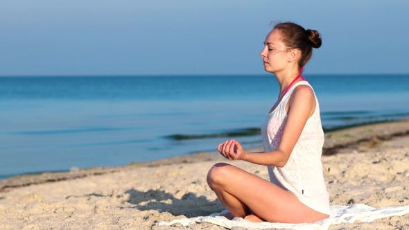 Thumbnail for Yoga On The Beach, Calm, Tranquility, Relaxation, Sexy Girl Meditating At Sunrise On The Ocean.