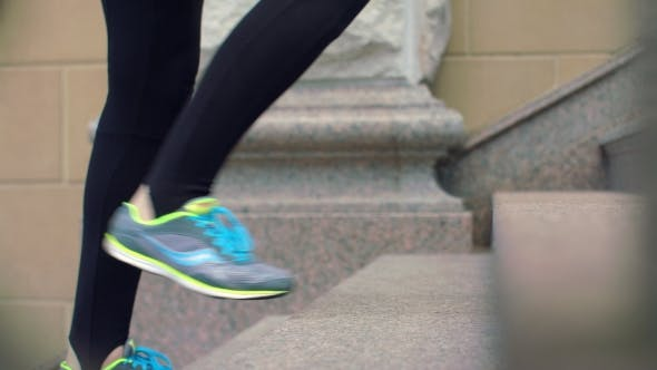 Thumbnail for Sport Woman Legs Walking Up Stairs.  Of Legs In Sport Shoes Move Up