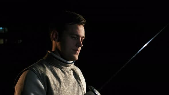 Thumbnail for Portrait Of Young Fencer Man Looking Into Camera On The Street.