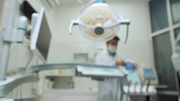 Thumbnail for Dentist Preparing To Operation