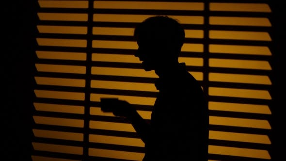 Thumbnail for Man Drinking Coffee From a Cup. Silhouette.