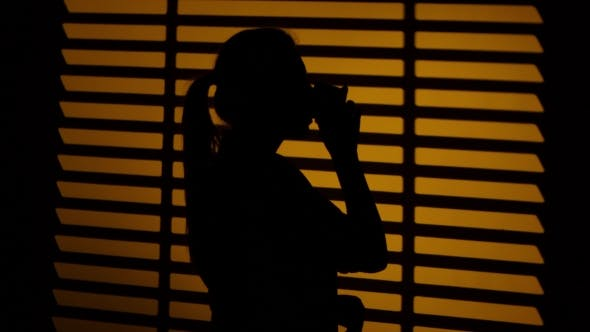 Thumbnail for Woman Drinking Coffee From a Cup. Silhouette.