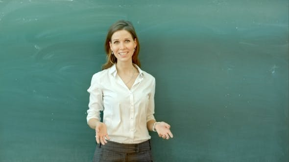 Thumbnail for Teacher Standing In Front Of Class Asking Question