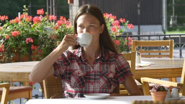 Thumbnail for Girl Drinks Coffee In The Morning